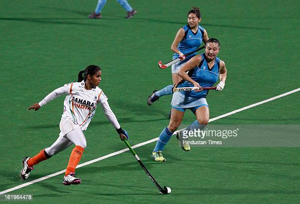 Indian Women Hockey Player Vandana Katariya dribble past Kazakhstan players during the Hockey World League Round 2 match at Dhyan Chand Stadium in...