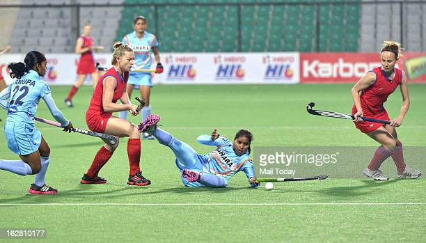 Indian Women Hockey team players vies for the ball with Russia player during their FIH Hockey World League Round 2 match at National stadium on Sunday