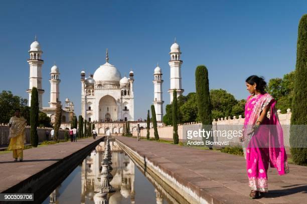 Indian women in front of Bibi-qa-Maqbara in Aurangabad, Maharashtra, India