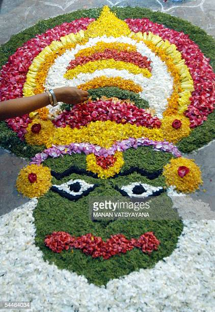 Indian women make a pookalam or floral art during a contest in New Delhi 04 September 2005 ahead of the Onam festival The Onam festival is a harvest...