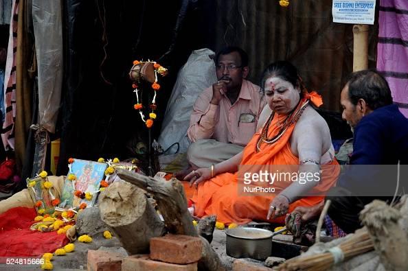 Indian Women Naga Sadhu on his way to the annual holy dip