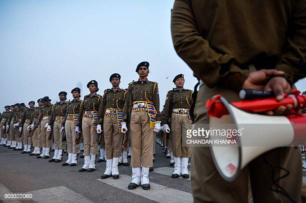 Indian women of the Central Reserve Police Force march during a rehearsal for the forthcoming Republic Day parade on a foggy winter morning at...