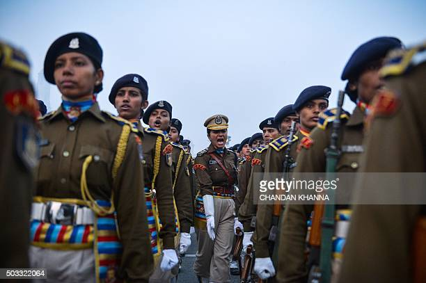 TOPSHOT Indian women of the Central Reserve Police Force march during a rehearsal for the forthcoming Republic Day parade on a foggy winter morning...
