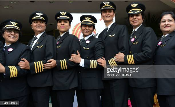Indian women pilots from Air India pose for a photograph during an event on the eve of International Women's Day in New Delhi on March 7 2017 A...