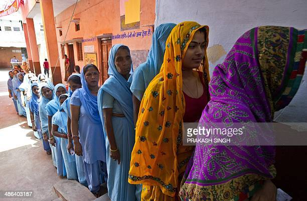 Indian women queue to cast their votes at a polling booth in Alwar on April 24 2014 India's 814millionstrong electorate is voting in the world's...