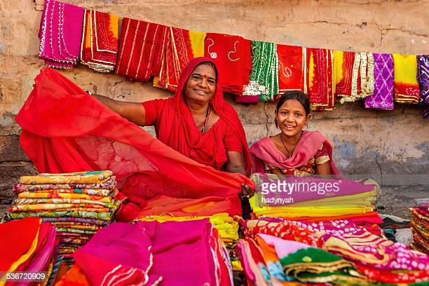 Indian women selling colorful fabrics