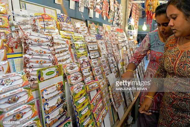 Indian women shop for 'rakhi' on the eve of the Hindu festival 'Raksha Bandhan' in Bangalore on August 28 2015 The 'Raksha Bandhan' ritual is...