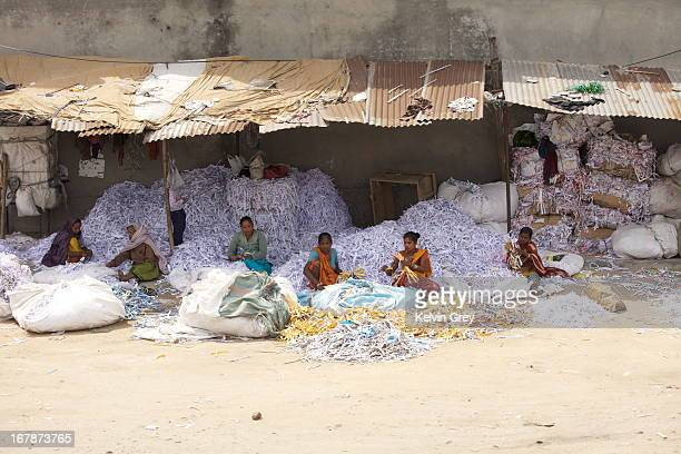Indian women sorting paper in a stage of recycling.