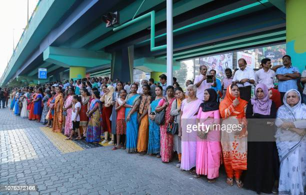 Indian women stand in a line to take part in a women's wall protest in Kochi in southern Kerala state on January 1 2019 Tens of thousands of women...