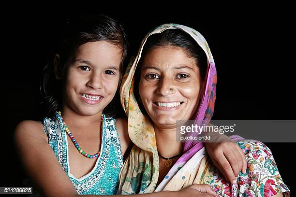 Indian Women Standing with Her Daughter