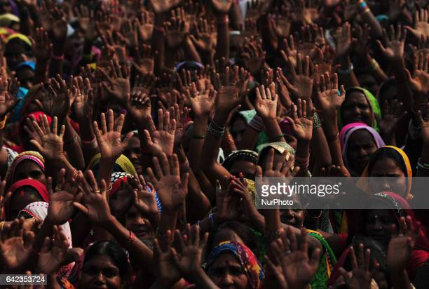 Indian women supporters of Bahujan Samaj Party wave hands during Party Chief mayawati's speech in a public rally ahead of Uttar Pradesh's Assembly...