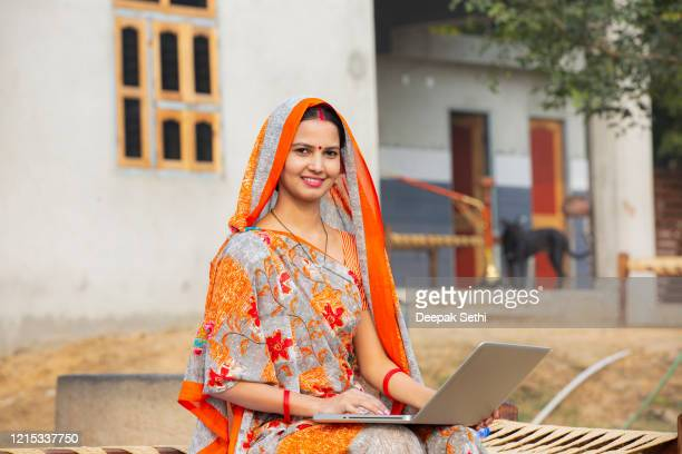 indian women using laptop at village stock photo - india stock pictures, royalty-free photos & images