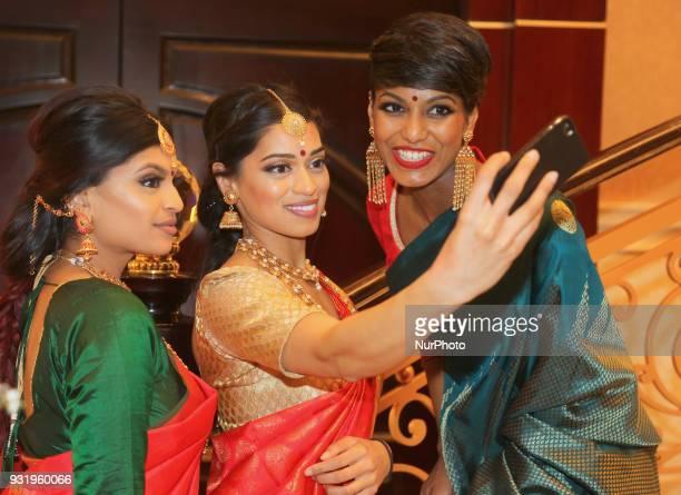Indian women wearing elegant and ornate Kanchipuram saris in Scarborough Ontario Canada