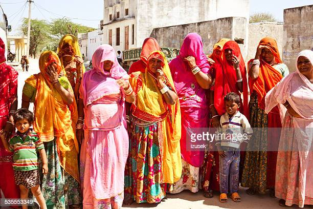 indian women wearing traditional clothes in village - izusek stock photos and pictures