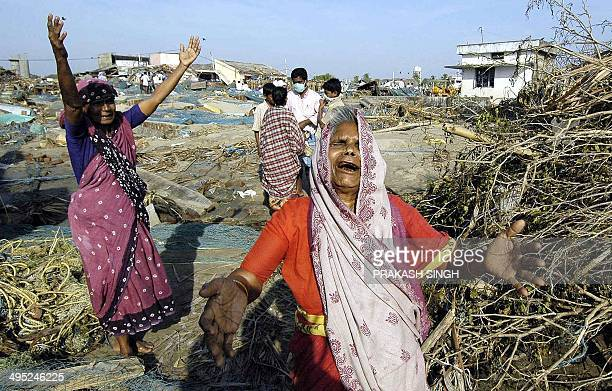 Indian women weep at the sight of their destroyed homes in Akarapatti fishers colony on the seashore near Nagapattinam port some 350 kms south of...