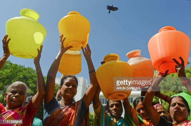 Indian women with empty plastic pots protest as they demand drinking water in Chennai on June 22, 2019. - Angry residents fight in queues at water...