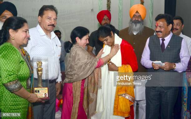 Indian women wrestler Navjot Kaur who won gold in the Senior Asian Wrestling championship in Bishkek, Kyrgyzstan receives an Dr BR Ambedkar Women...