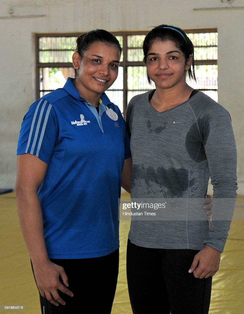 Indian Women wrestlers Suman Kundu and Sakshi Malik during the practice session at wrestling training centre on October 7 2015 in Rohtak India Sakshi.