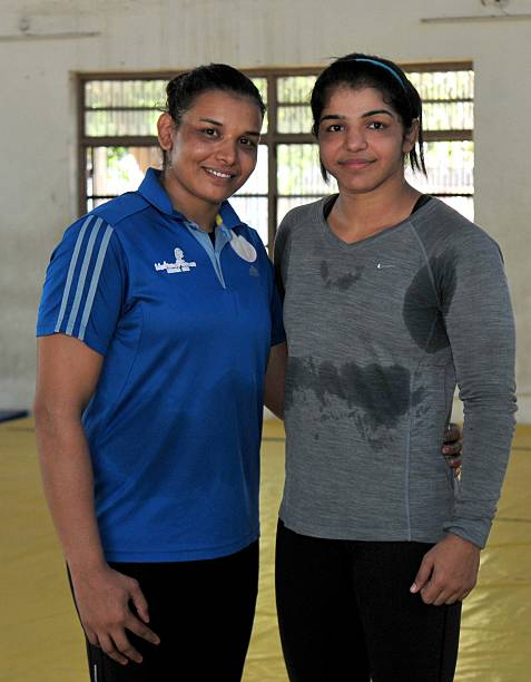 Indian Women wrestlers Suman Kundu and Sakshi Malik during the practice session at wrestling training centre on October 7 2015 in Rohtak India Sakshi.