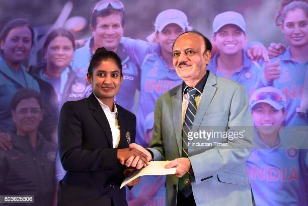 Indian Women's Cricket team captain Mithali Raj with BCCI Acting President C K Khanna during the felicitating event on July 27 2017 in New Delhi...