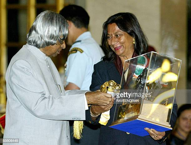 Indian women's cricket trainer Sunita Sharma receives the Dronacharya Award the second highest sports award from Indian President APJ Abdul Kalam at...