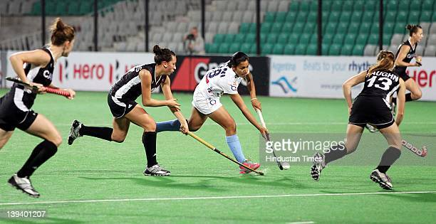 Indian Women's Hockey team player Rani Rampal makes a move against Canadian players during a FIH London 2012 Olympic Hockey Qualifying Tournament at...