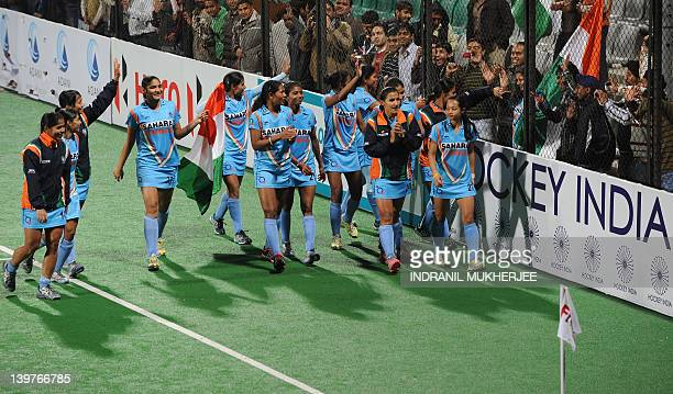 Indian women's hockey team waves to the crowd after winning the women's field hockey match between India and Italy of the FIH London 2012 Olympic...