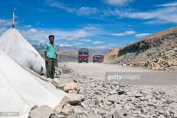 Indian Worker on Tanglang La Pass in Ladakh Himalaya India