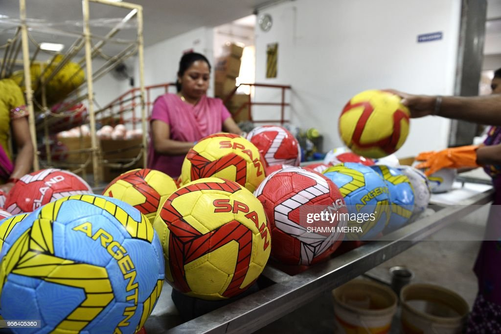Indian worker pack footballs ahead of the Russia 2018 FIFA World Cup at a manufacturing unit in Jalandhar on May 9 2018