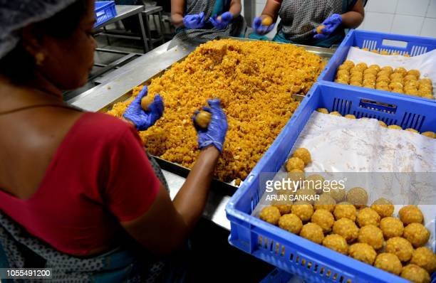 Indian worker prepare sweets at a production unit ahead of Diwali festival celebration in Chennai on October 30 2018 Diwali the Hindu festival of...