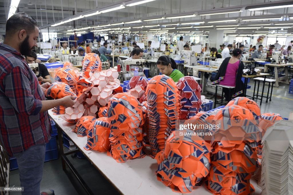 Indian worker stitch football ahead of the Russia 2018 FIFA World Cup at a manufacturing unit in Jalandhar on May 9 2018