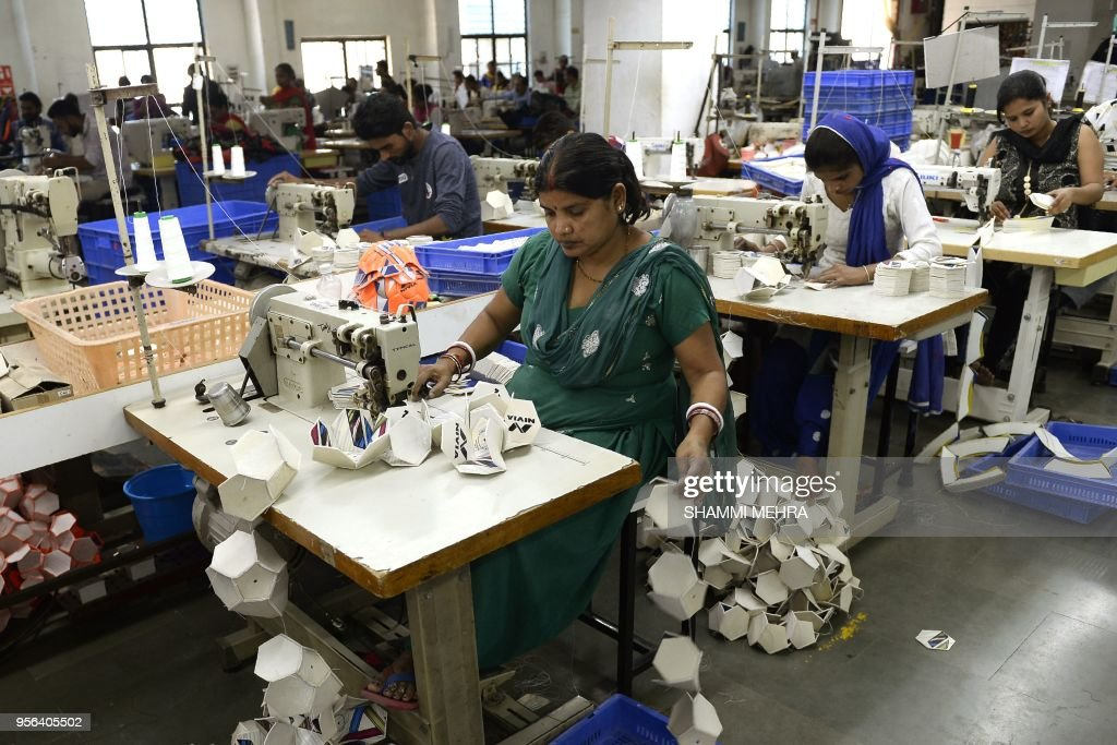 Indian worker stitch footballs ahead of the Russia 2018 FIFA World Cup at a manufacturing unit in Jalandhar on May 9 2018