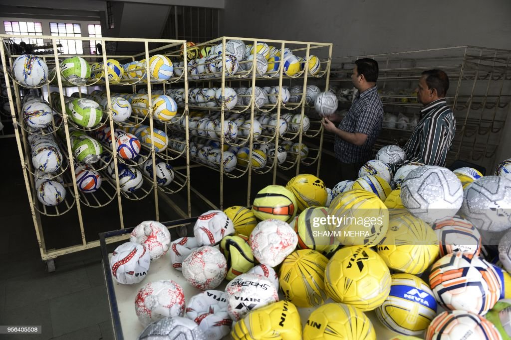 Indian worker store football ahead of the Russia 2018 FIFA World Cup at a manufacturing unit in Jalandhar on May 9 2018