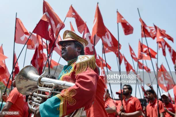 TOPSHOT Indian workers and members of various trade unions dressed in red take part in a rally on the occasion of International Workers' Day in...