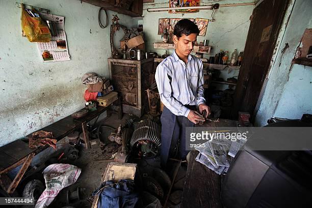 Indian workers: electrician's workshop