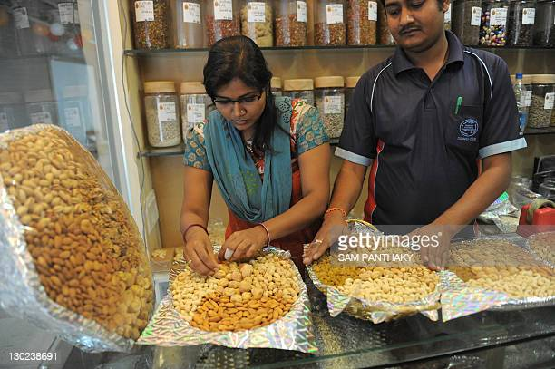 Indian workers gift wrap packets of dry fruits on the eve of Diwali in Ahmedabad on October 25 2011 During Diwali festivities the demand for dry...
