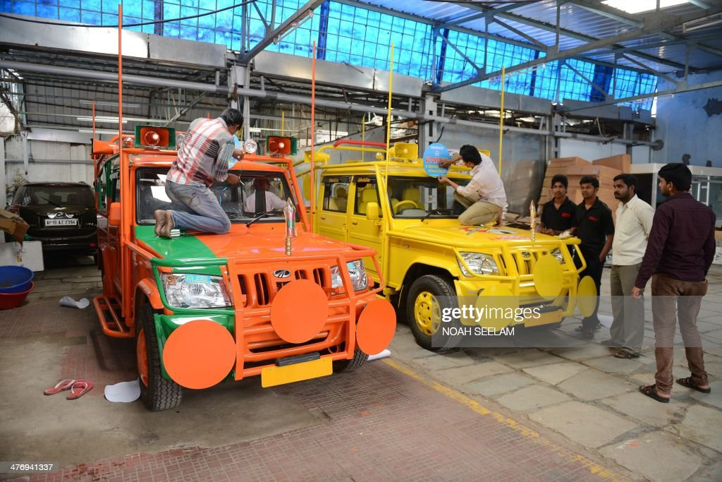 Indian Workers Give The Final Touches To Election Campaign Vehicles