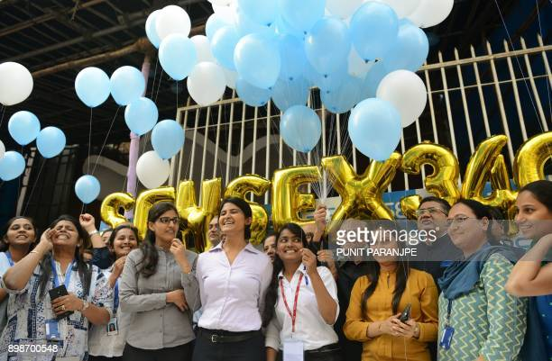 Indian workers holding balloons gather outside the Bombay Stock Exchange to celebrate the benchmark 30share index SENSEX crossing 34000 points in...