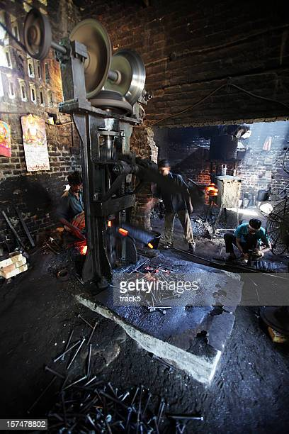 Indian workers: manufacturing plant