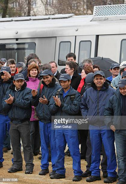 Indian workers of Canadian company Bombardier who trained for four weeks at the Goerlitz Bombardier factory Germany stand in front of a subway car...