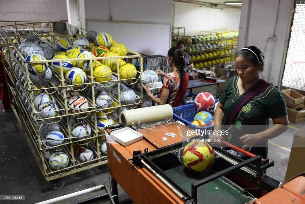 Indian workers pack footballs ahead of the Russia 2018 FIFA World Cup at a manufacturing unit in Jalandhar on May 9 2018