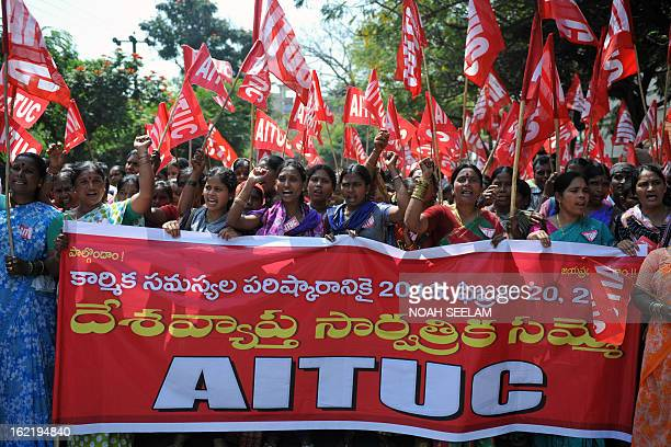 Indian workers participate in a rally during a twoday strike called by trade unions opposing the current UPA governments economic policies in...