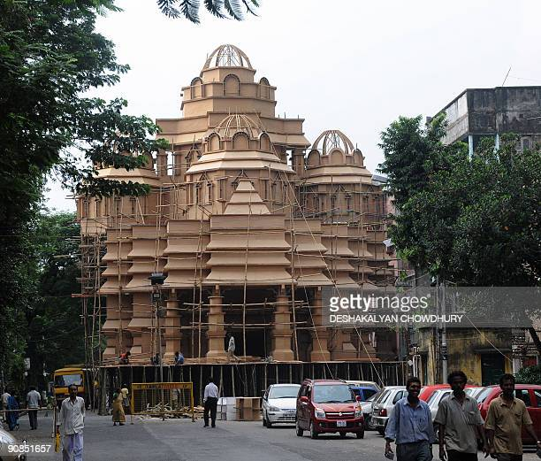 Indian workers prepare a makeshift Durga temple based on the famous Hindu temple of Akshardham in Kolkata on September 16 2009 Durga Puja the annual...