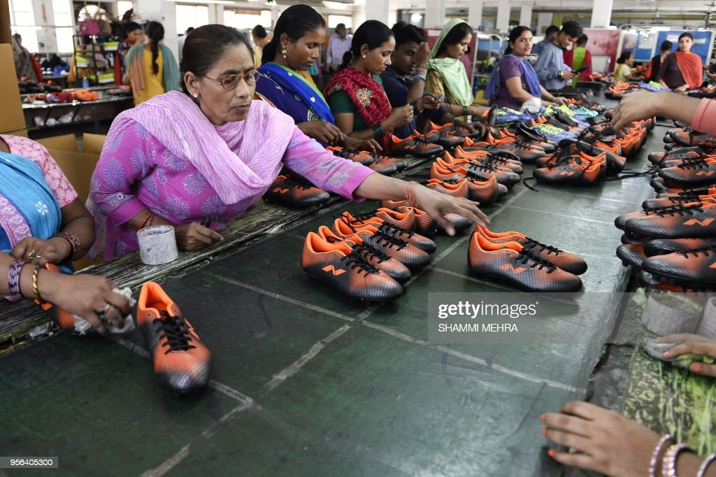 Indian workers produce football boots ahead of the Russia 2018 FIFA World Cup at a manufacturing unit in Jalandhar on May 9 2018