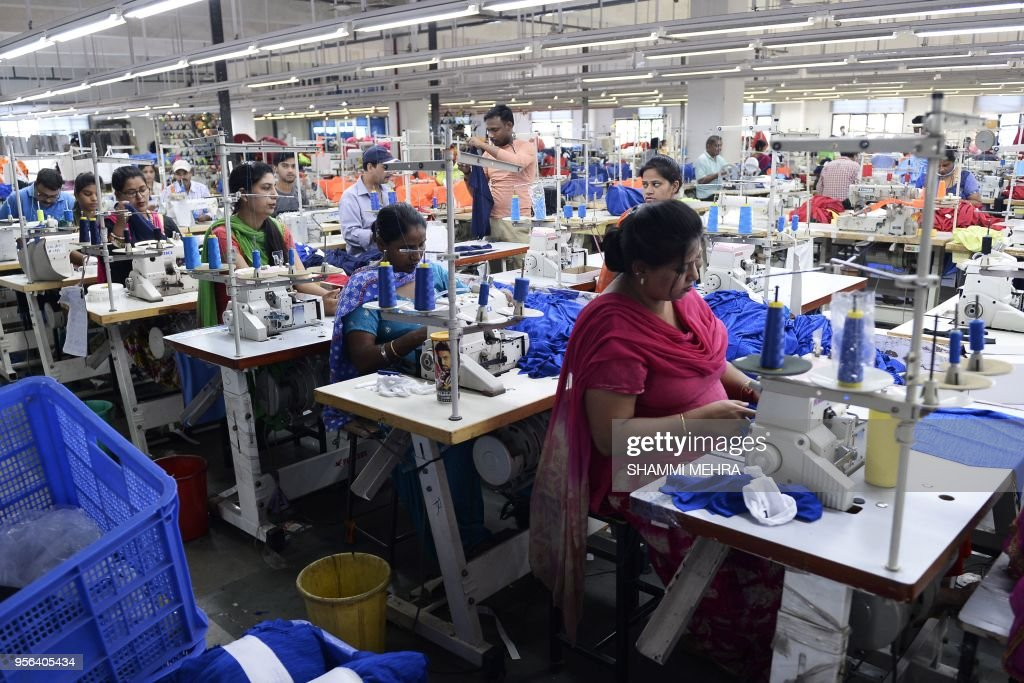 Indian workers produce footballs and football shirts ahead of the Russia 2018 FIFA World Cup at a manufacturing unit in Jalandhar on May 9 2018