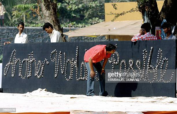 Indian workers set up a sign reading An other world is possible at the venue of the 2004 World Social Forum in Bombay 15 January 2004 Some 78000...