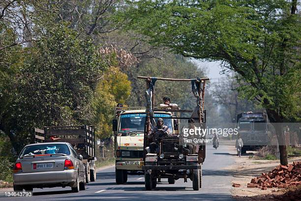 Indian workers travel in brightly coloured truck in Agra Uttar Pradesh India