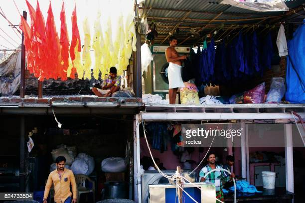 Indian workers washing clothes at Dhobi Ghat in Mumbai, India