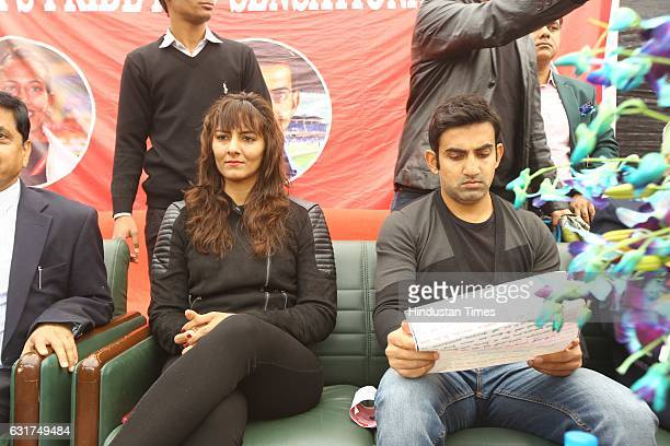 Indian wrestler Geeta Phogat and cricketer Gautam Gambhir during the centennial celebrations at Ramjas College Delhi University on January 12 2017 in...