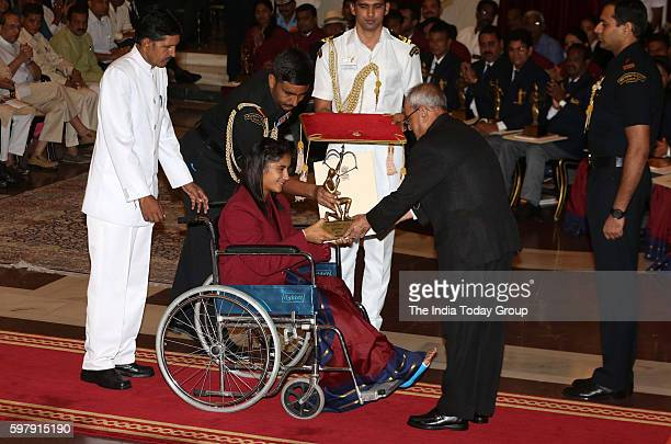 Indian wrestler Vinesh Phogat receives Arjuna Award from President Pranab Mukherjee during sports award function at the Indian president's palace in...